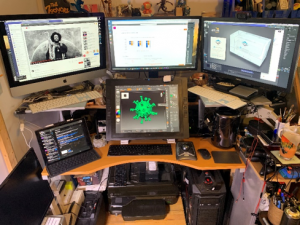 home office setup with multiple screens